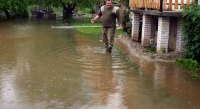 Poplavljeni podrumi kuća, ceste i njive